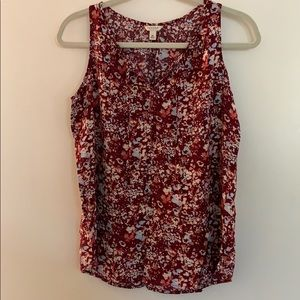 Gently used dark pink and floral print tank top